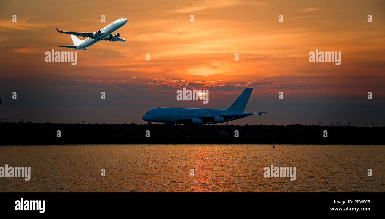 A colourful Sunset Seascape with an airborne passenger jet airliner flying high in the orange coloured cirrostratus cloudy sky over a taxying aircraft - Stock Image