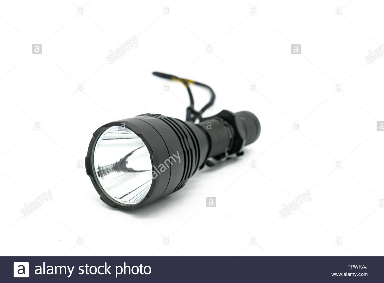 Black flashlight on white background. - Stock Image