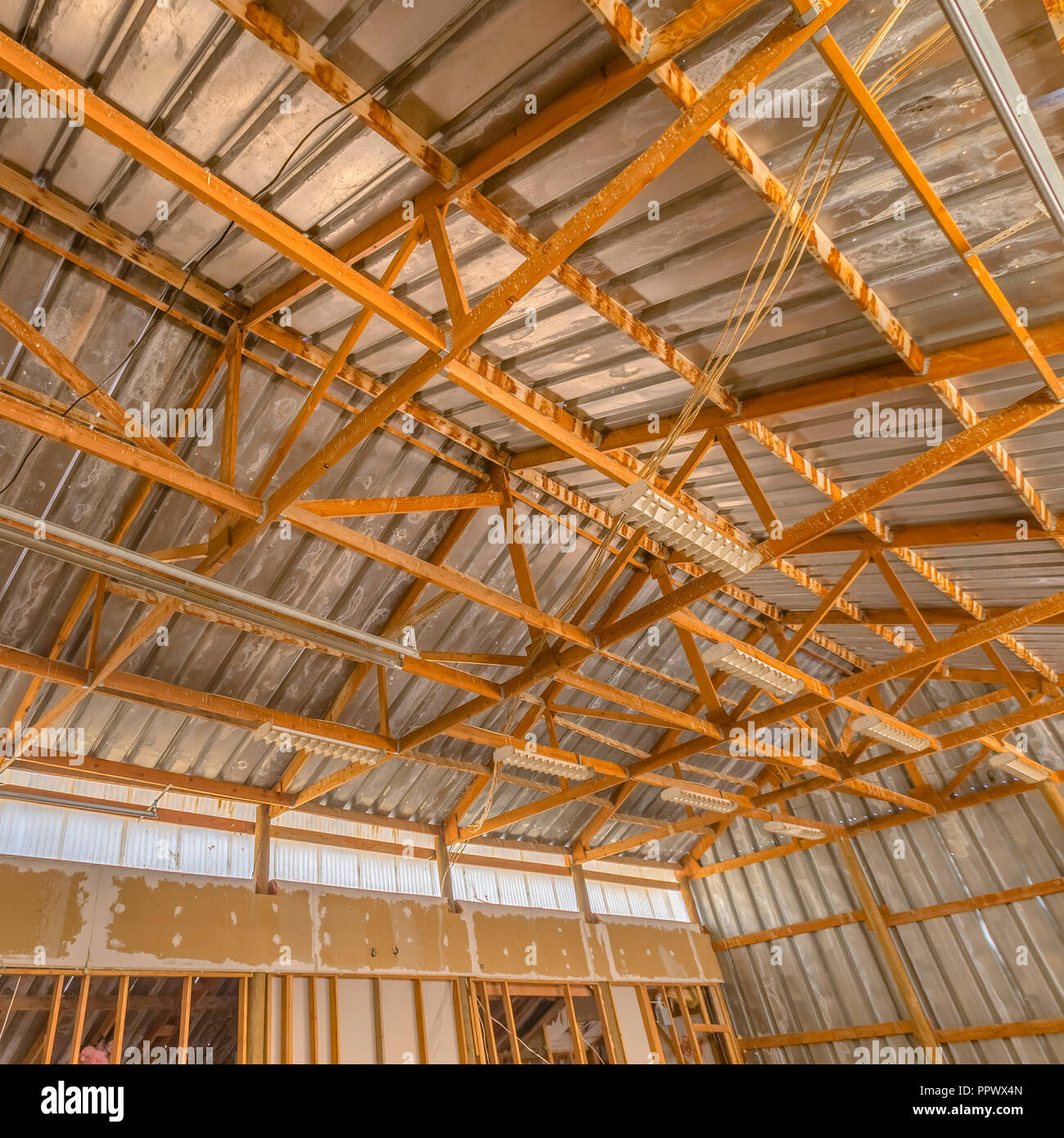 Interior of a barn with metal roof and walls - Stock Image