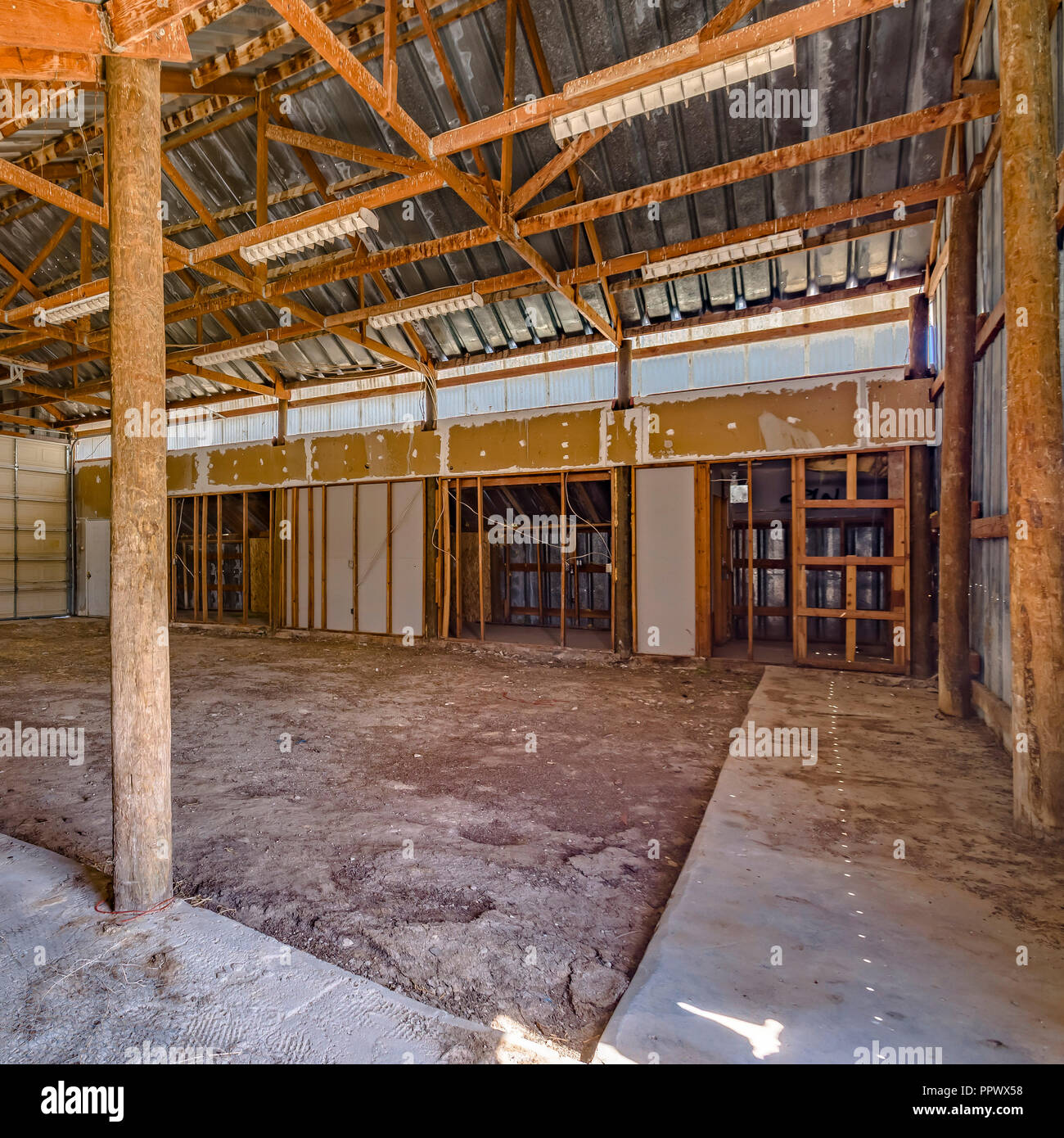 Interior view of an empty aged barn - Stock Image