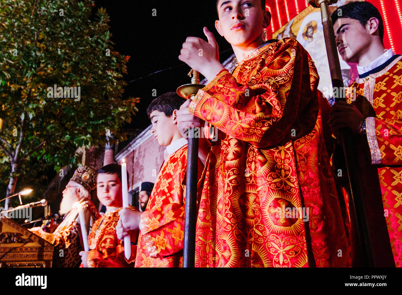 Tirana, Albania : Acolytes and priest during the celebration of the Orthodox Easter in the streets of Tirana. - Stock Image