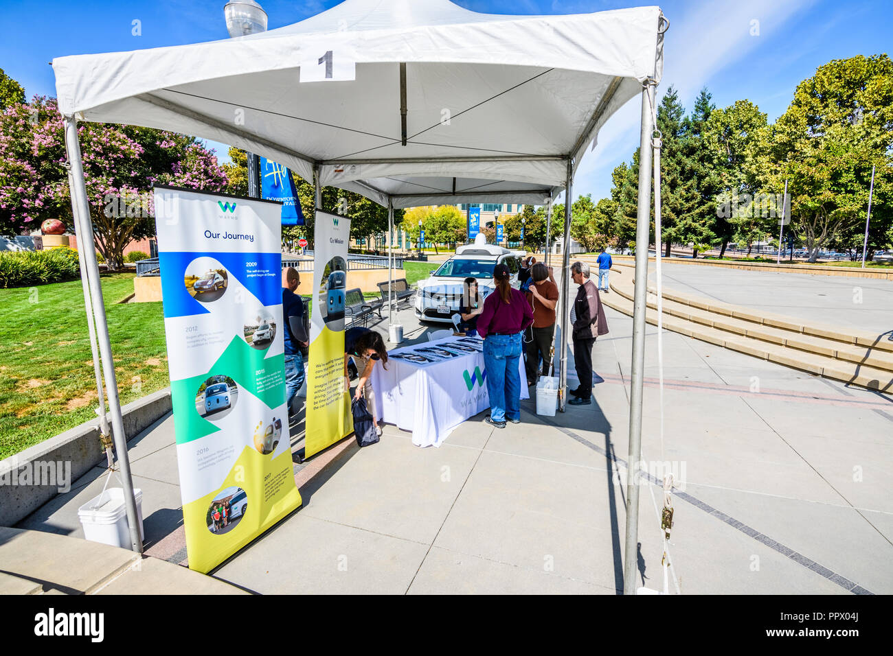 September 27, 2018 Sunnyvale / CA / USA - Representatives from Waymo talk to visitors at 'Sunnyvale Technology Business Expo' in Silicon Valley - Stock Image