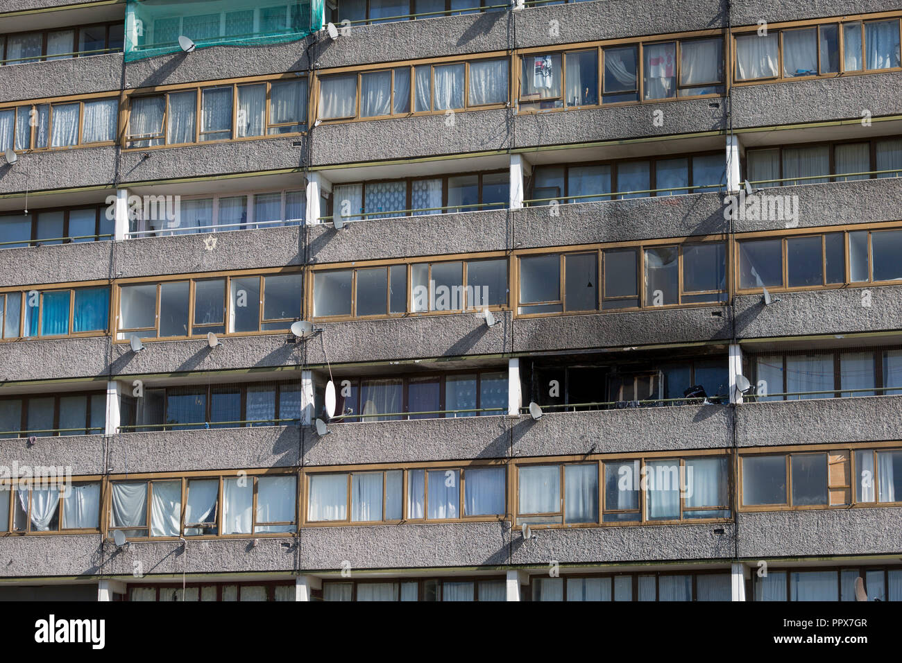 Smoke damage aftermath on the exterior of a flat fire in one of the two Wendover blocks on Alsace Road on the Aylesbury Estate, Southwark SE17, on 24th September 2018, in London, England. Part of a split level flat on the fourth and fifth floor of the 15-storey block was damaged. One woman and two children left the property before the Brigade arrived. They were treated at the scene for smoke inhalation by London Ambulance Service crews and taken too hospital. Another man was also treated at the scene for smoke inhalation. - Stock Image