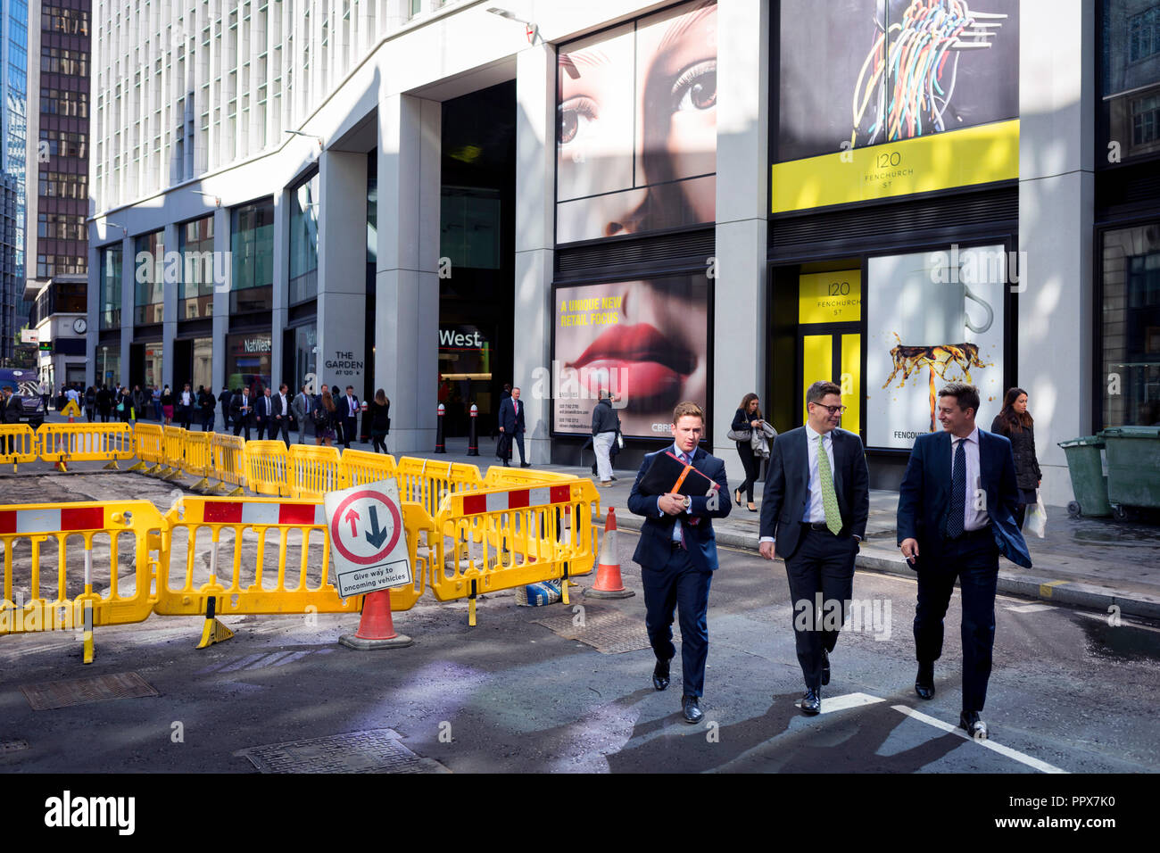 A pair of eyes and passers-by on Fenchurch Street - in the heart of the capital's financial district (aka The Square Mile), on 24th September 2018, in London, England. - Stock Image