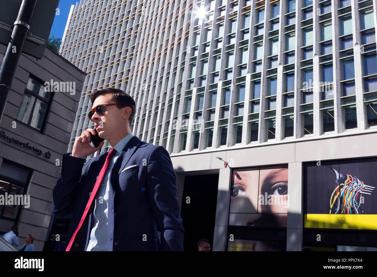 A pair of eyes and a male passer-by on Fenchurch Street - in the heart of the capital's financial district (aka The Square Mile), on 24th September 2018, in London, England. - Stock Image