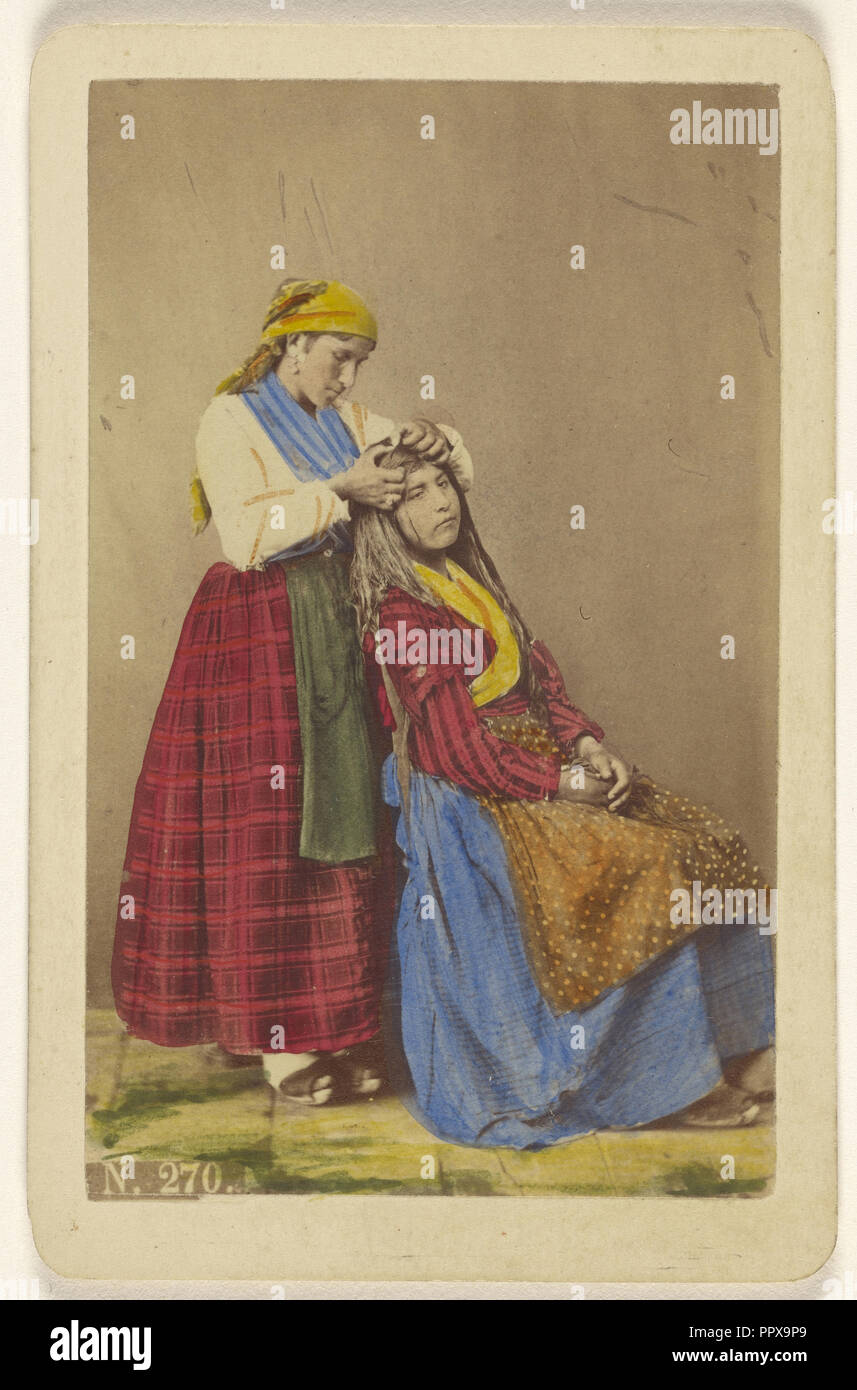 Older woman doing the hair of a younger woman; Giorgio Conrad, Italian, active 1860s, about 1870; Hand-colored albumen silver - Stock Image