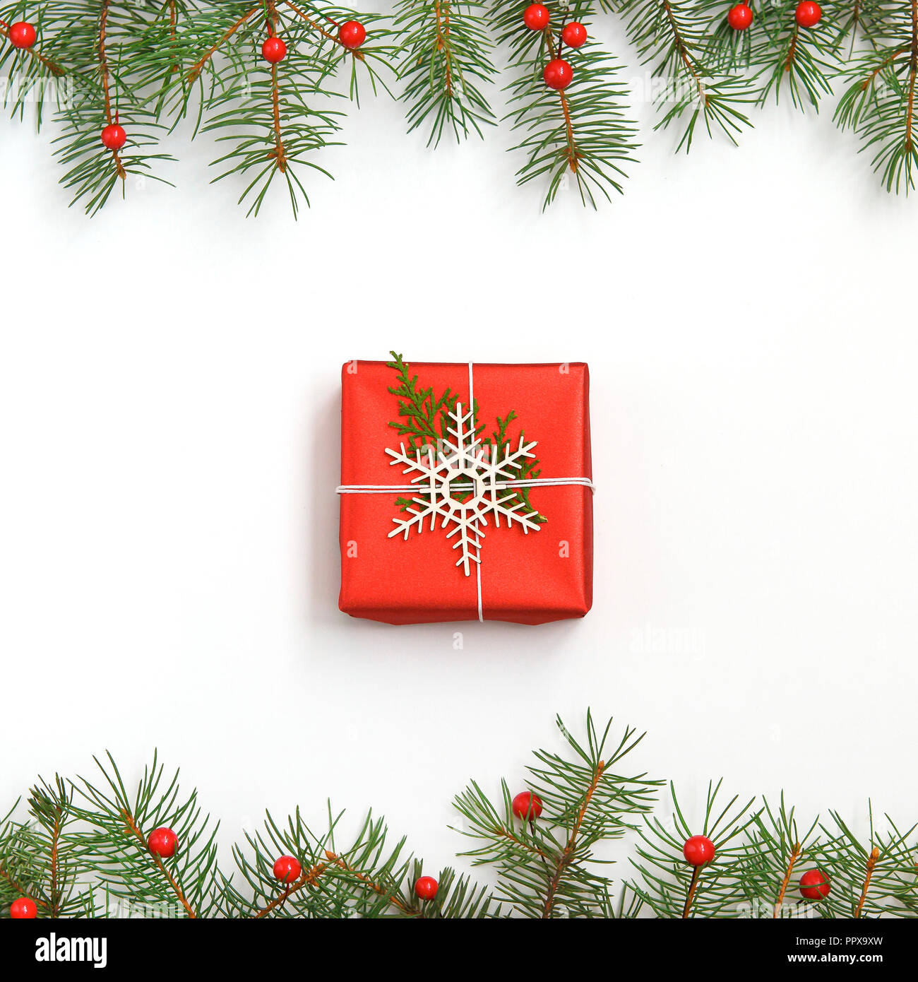 Christmas red gift box decorated on white background top view ...