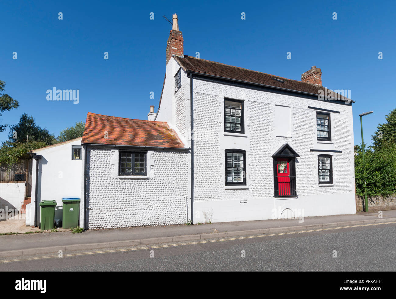 Grade II listed (grade 2 listed) white period house with raised front door & cellar in Littlehampton, West Sussex, UK. - Stock Image