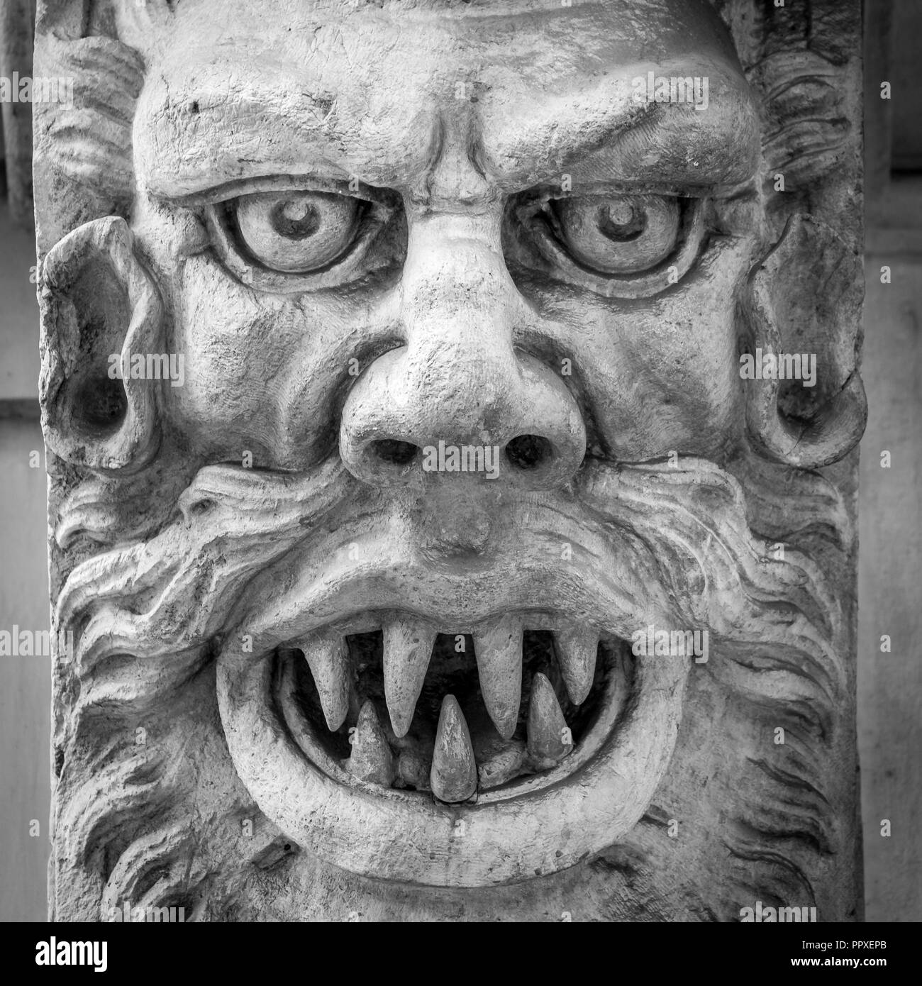 Italy, Turin. This city is famous to be a corner of two global magical triangles. This is a protective mask of stone on the top of a luxury palace ent - Stock Image