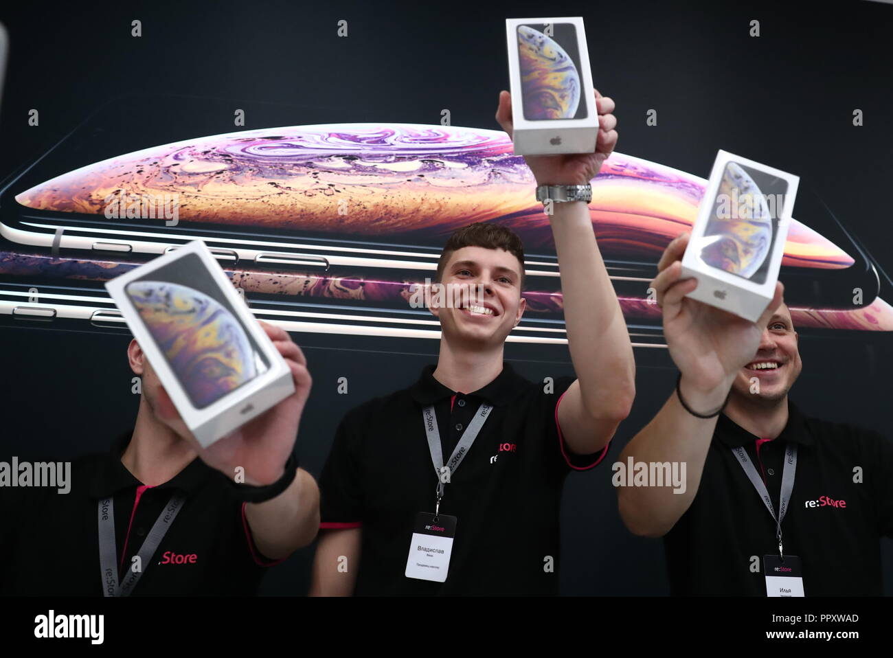 Moscow, Russia. 28th Sep, 2018. MOSCOW, RUSSIA - SEPTEMBER 28, 2018: re:Store shop assistants as Apple launches iPhone XS, iPhone XS Max, and iPhone XR sales in Russia. Anton Novoderezhkin/TASS Credit: ITAR-TASS News Agency/Alamy Live News - Stock Image