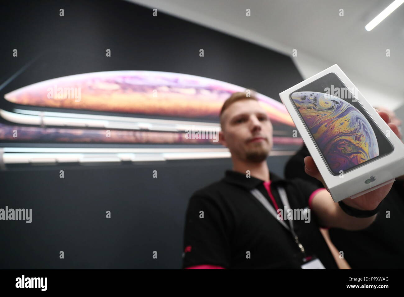 Moscow, Russia. 28th Sep, 2018. MOSCOW, RUSSIA - SEPTEMBER 28, 2018: A re:Store shop assistant as Apple launches iPhone XS, iPhone XS Max, and iPhone XR sales in Russia. Anton Novoderezhkin/TASS Credit: ITAR-TASS News Agency/Alamy Live News - Stock Image