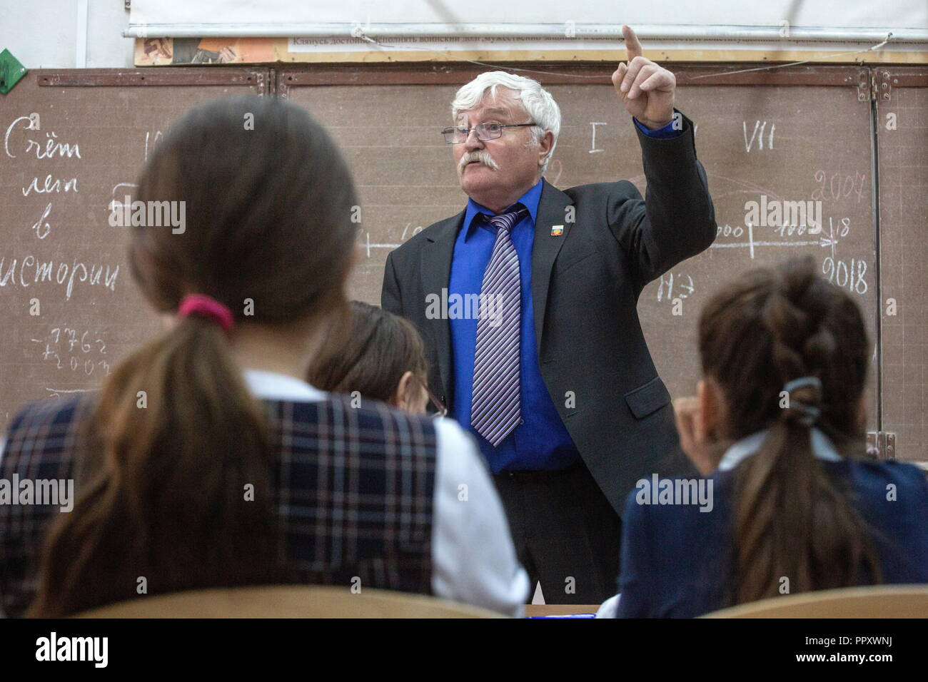 Russia. 27th Sep, 2018. OMSK REGION, RUSSIA - SEPTEMBER 27, 2018: Yakov Savenok, 65, teaches a history class at a secondary school in the village of Bogoslovka. Dmitry Feoktistov/TASS Credit: ITAR-TASS News Agency/Alamy Live News - Stock Image