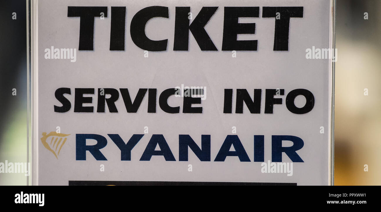 28 September 2018, Hessen, Frankfurt_Main: A sign 'Ticket Service Info Ryanair' is placed on a counter. Trade unions in several European countries have called for strikes at low-cost airline Ryanair. In Germany, the pilots of the Cockpit Association (VC) and the flight attendants organized at Verdi participate. Photo: Andreas Arnold/dpa - Stock Image