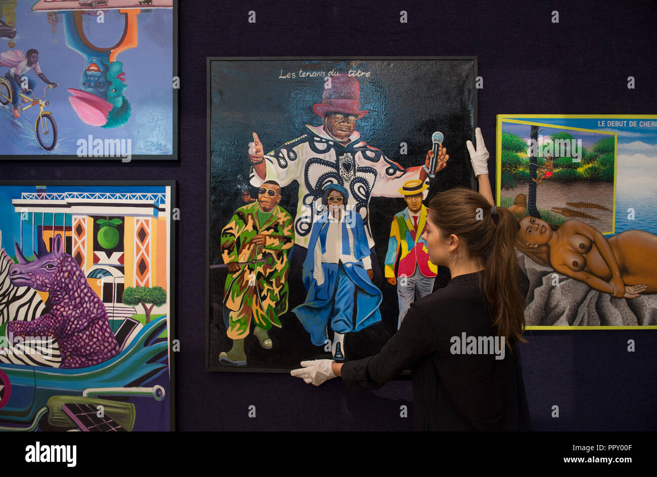 Bonhams, New Bond Street, London, UK. 28 September, 2018. Works from the exhibition, including highly regarded artists such as Chéri Samba, Aimé Mpane, and Freddy Tsimba, will be offered at Bonhams Africa Now sale on Thursday 4 October. Credit: Malcolm Park/Alamy Live News. - Stock Image