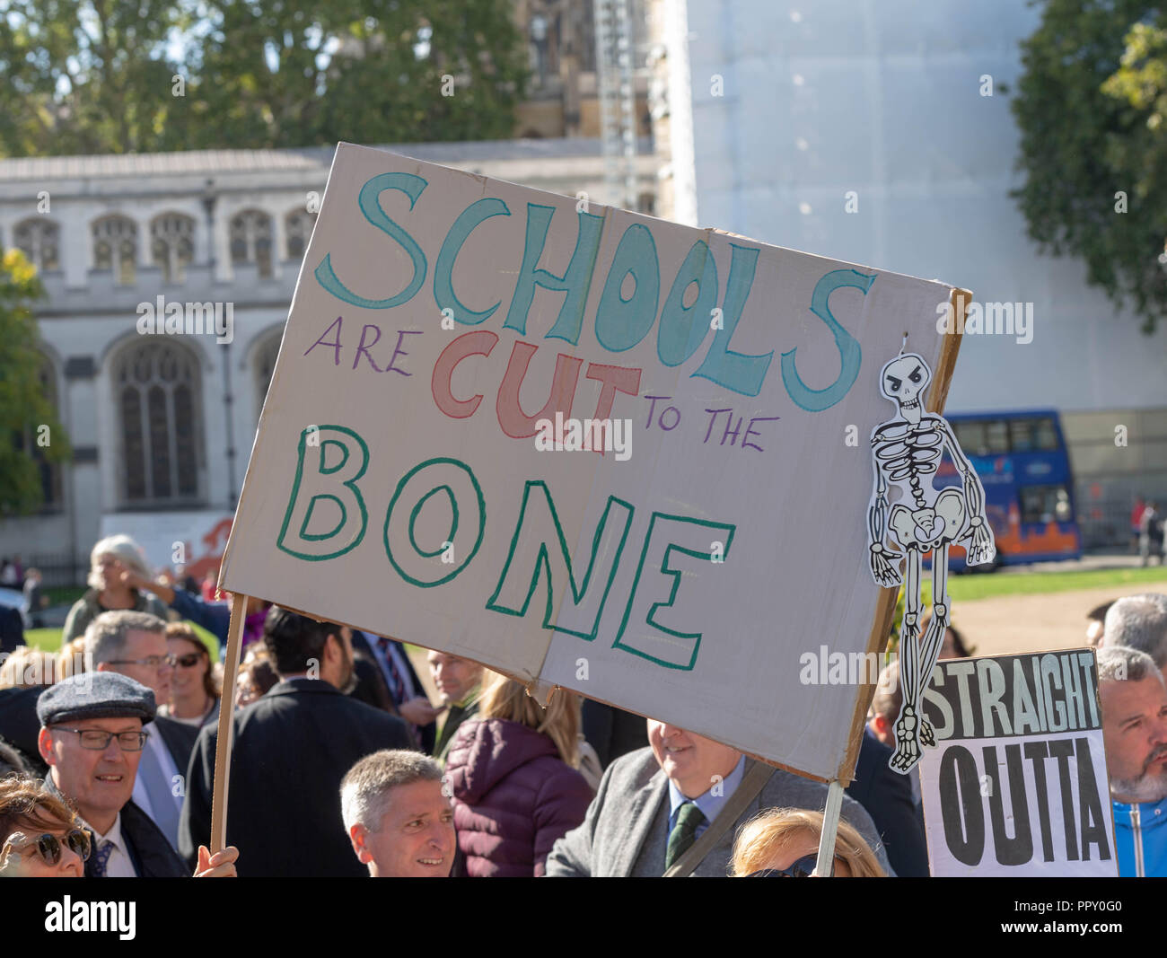 London 28th September 2018  Head Teachers rally in Westminster seeking an increase in educational funding. Head Teachers with a 'Schools cut to the Bone home made banner at the proest Credit Ian Davidson/Alamy Live News - Stock Image