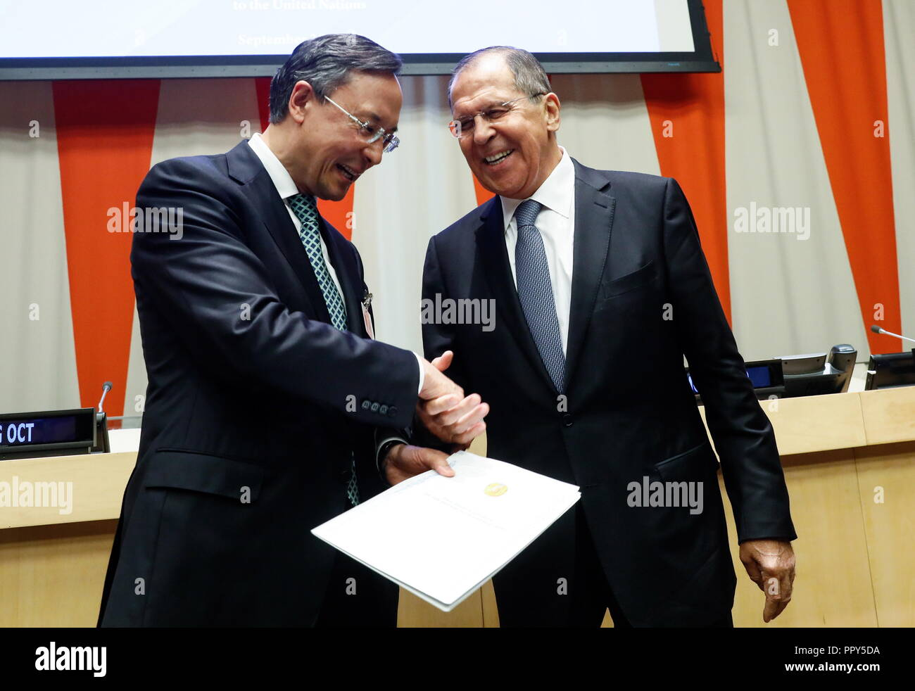 "New York City, USA. 29th Sep, 2018. NEW YORK CITY, USA - SEPTEMBER 28, 2018: Kazakhstan's Foreign Minister Kairat Abdrakhmanov (L) and Russia's Foreign Minister Sergei Lavrov during a ceremony to sign the ""Codex to achieve the world free from terrorism"" prepared by Kazakhstan on the sidelines of the 73rd session of the United Nations General Assembly at the UN headquarters. Alexander Shcherbak/TASS Credit: ITAR-TASS News Agency/Alamy Live News Stock Photo"