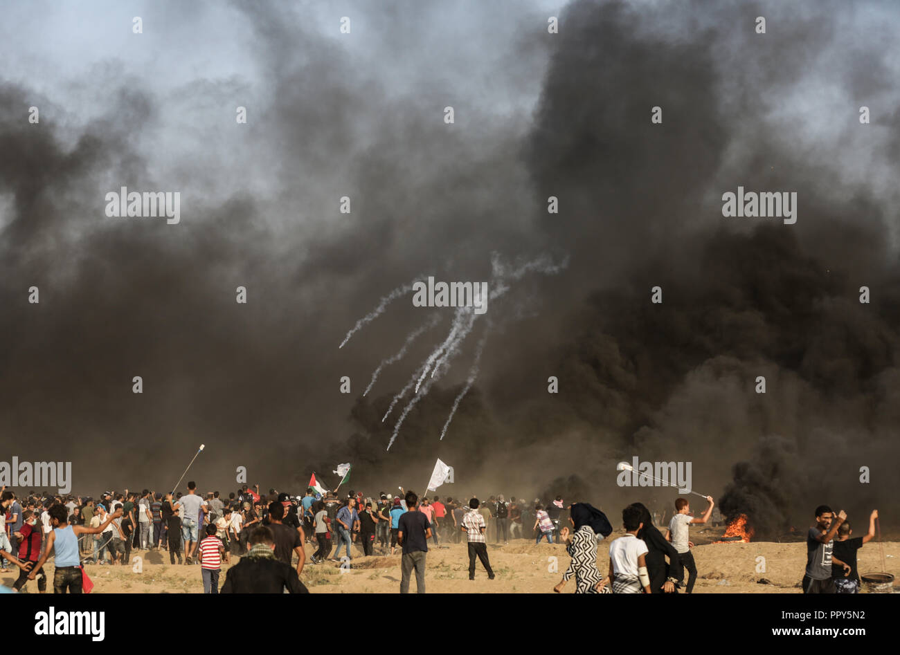 protesters seen reacting as tear gas canisters are being fired by israeli forces rain down during the clashes7 palestinians including a 14 year old