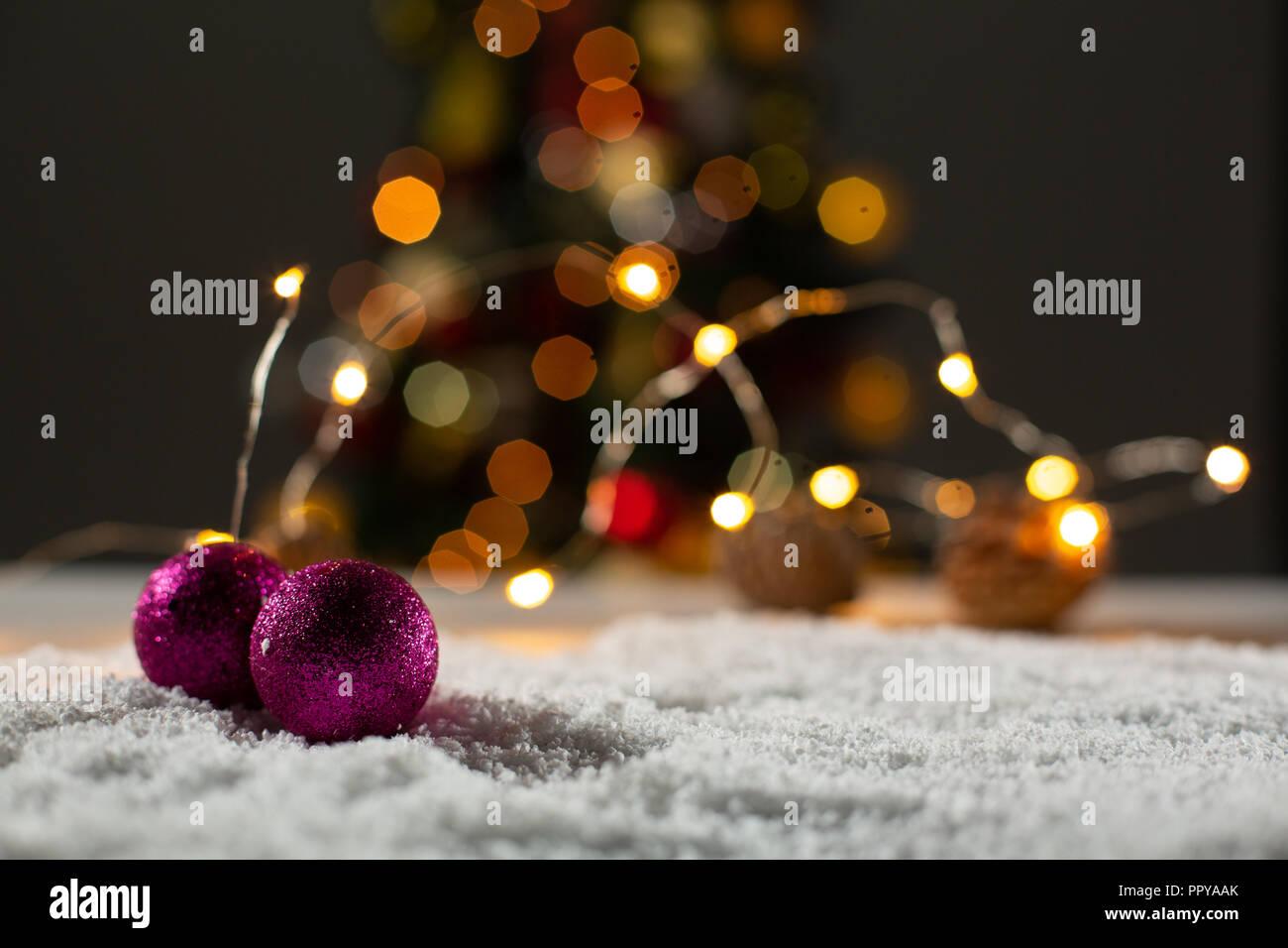 Christmas balls against unfocused tree - Stock Image