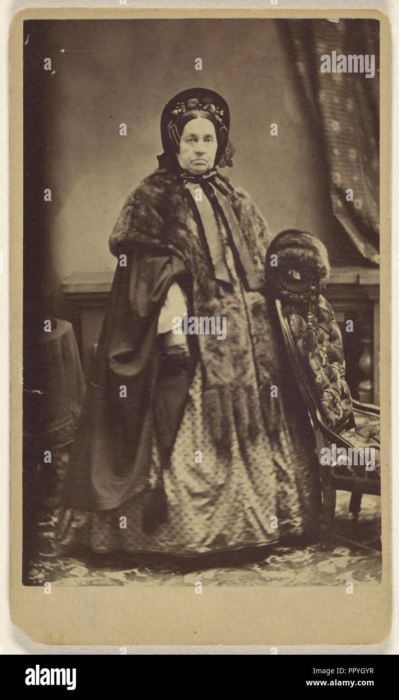 elderly woman wearing a fur coat and hat, standing; Partridge, American, active Bridgeport, Connecticut 1870s - 1890s, 1865 Stock Photo