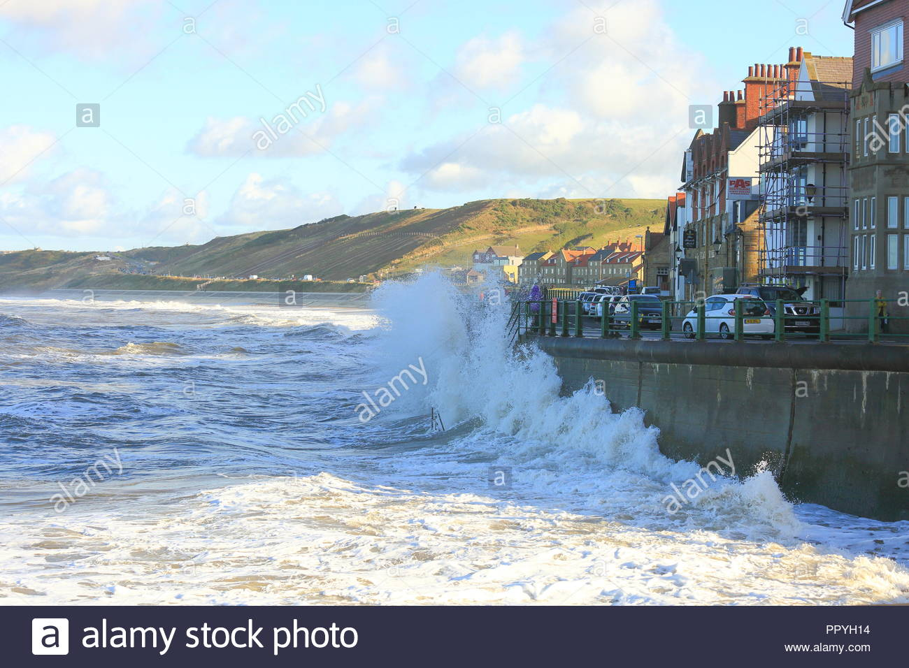 Crashing waves at the sea front at Sandsend, Whitby, North Yorkshire, UK. September 2018 - Stock Image