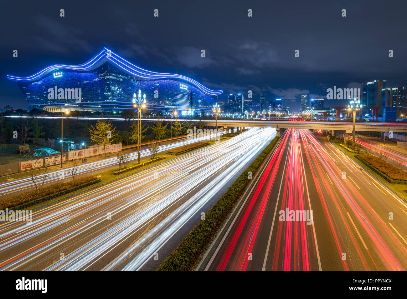 Chengdu, Sichuan province, China - Sept 27, 2018: Traffic light trails on Tianfu avenue at night with illuminated New Century Global Center in the background Stock Photo