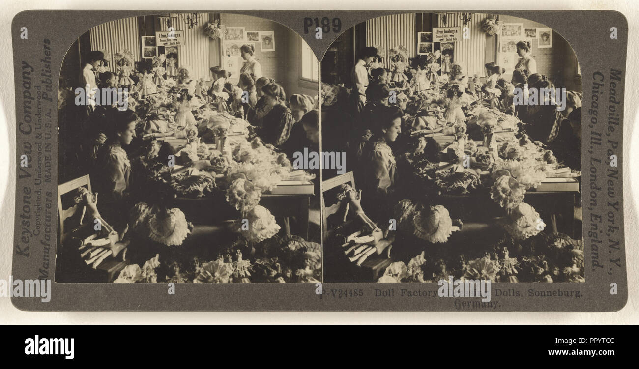 Doll Factory, Dressing Dolls, Sonneburg, Germany, 1881 - 1940s, about 1920; Gelatin silver - Stock Image