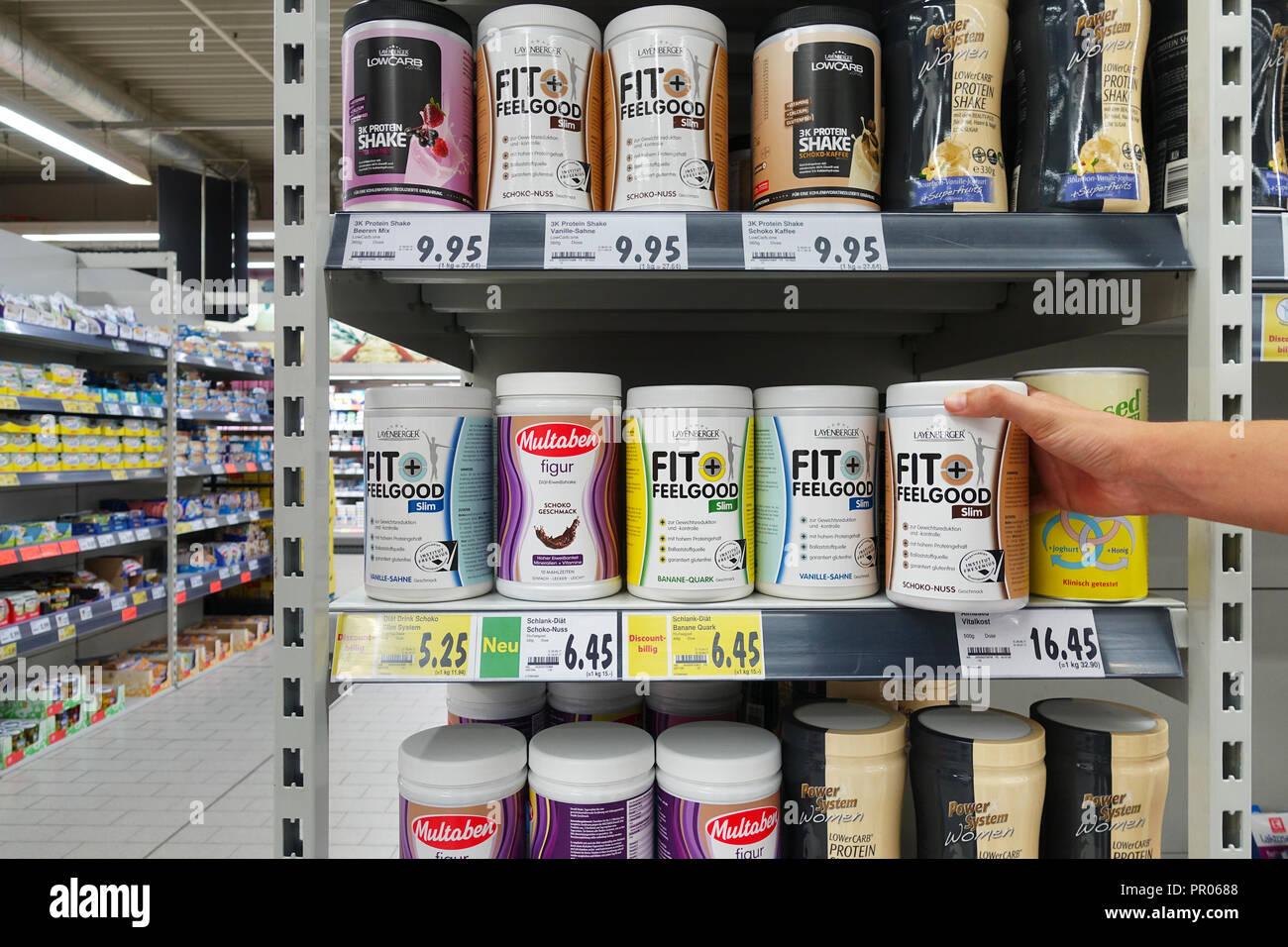 High protein drinks and bodybuilding supplements in a supermarket - Stock Image