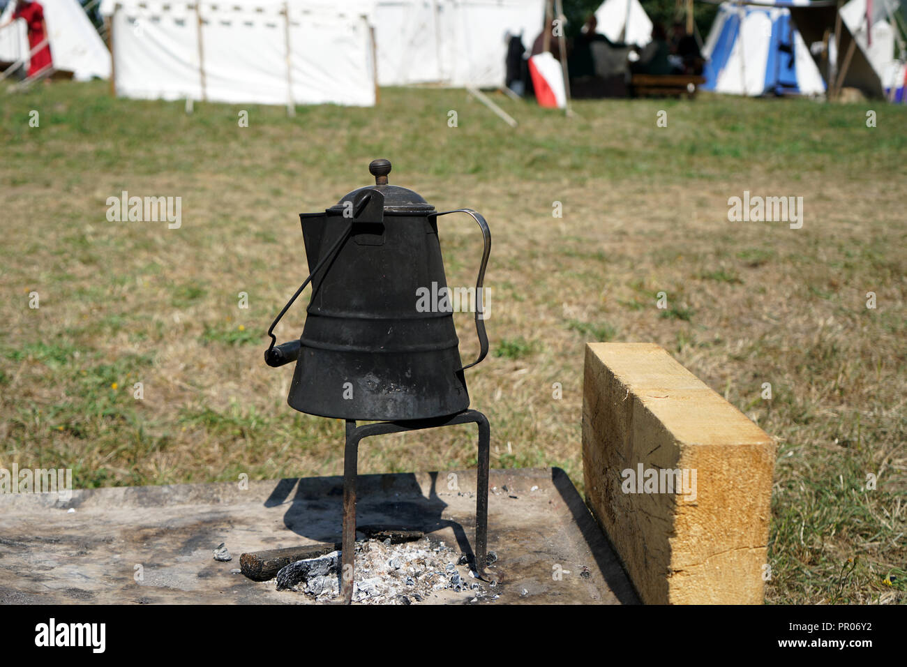 Primitive cooking on open flame with old pots and pans in Germany on a feast - Stock Image