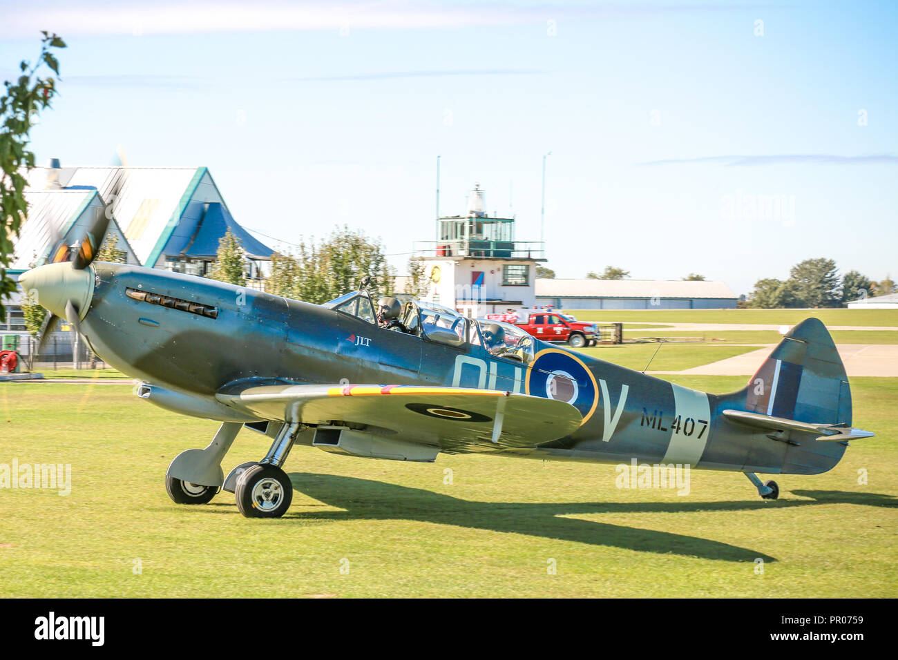 A two seater Spitfire running flight experience trips from Sywell aerodrome - Stock Image