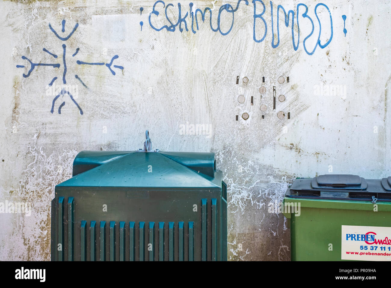 Garbage containers and graffito saying ESKIMO BIMBO, Harbolle Havn on Moen Island, Denmark, Scandinavia, Europe. - Stock Image