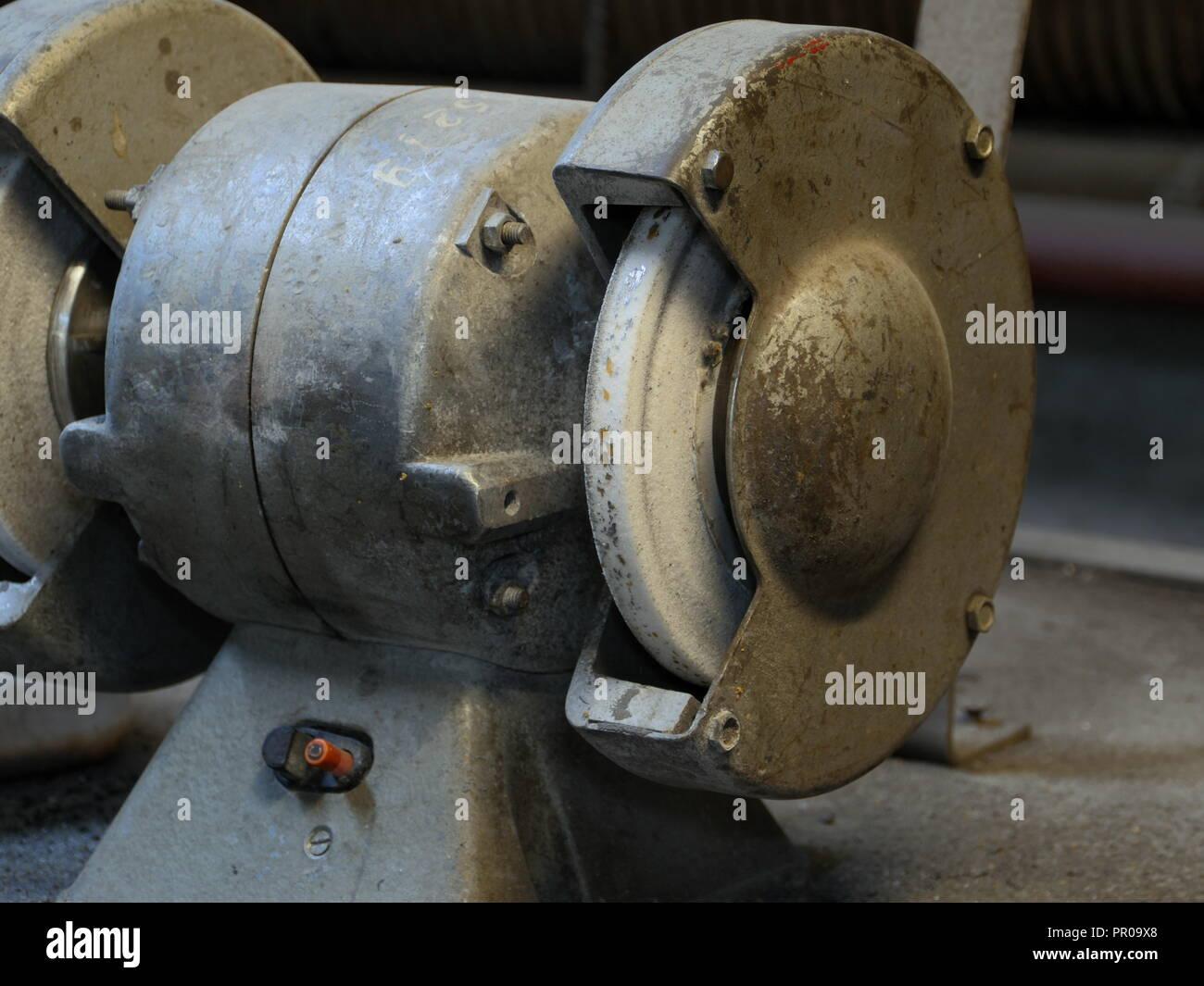 old sharpened machine in workshop - Stock Image