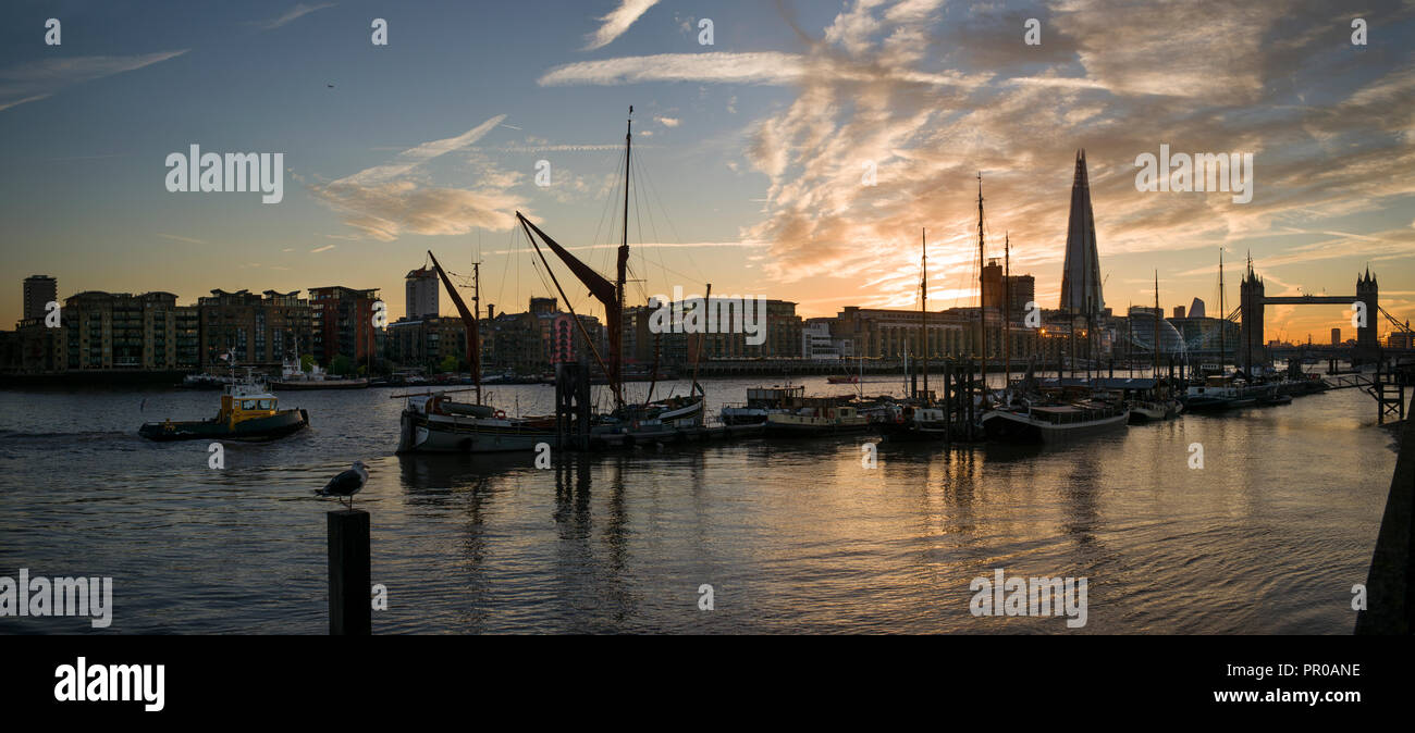 London, England UK. Stunning sunset over Tower Bridge and The Shard and River Thames with Thames Barges at Sunset dusk. 27 Sept 2018 - Stock Image