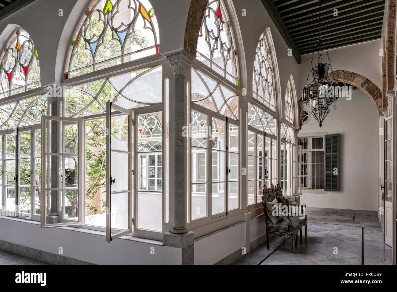 Nine glazed arches form gallery above courtyard. - Stock Image