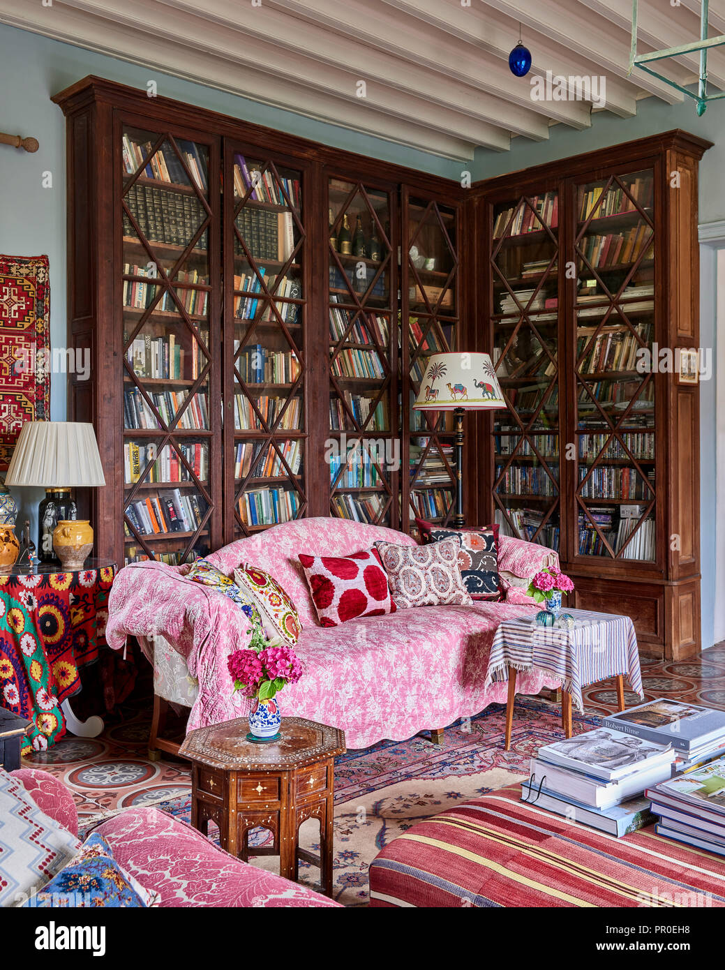 Fabric Covered Sofa With Tall Vintage Glass Fronted Bookcase