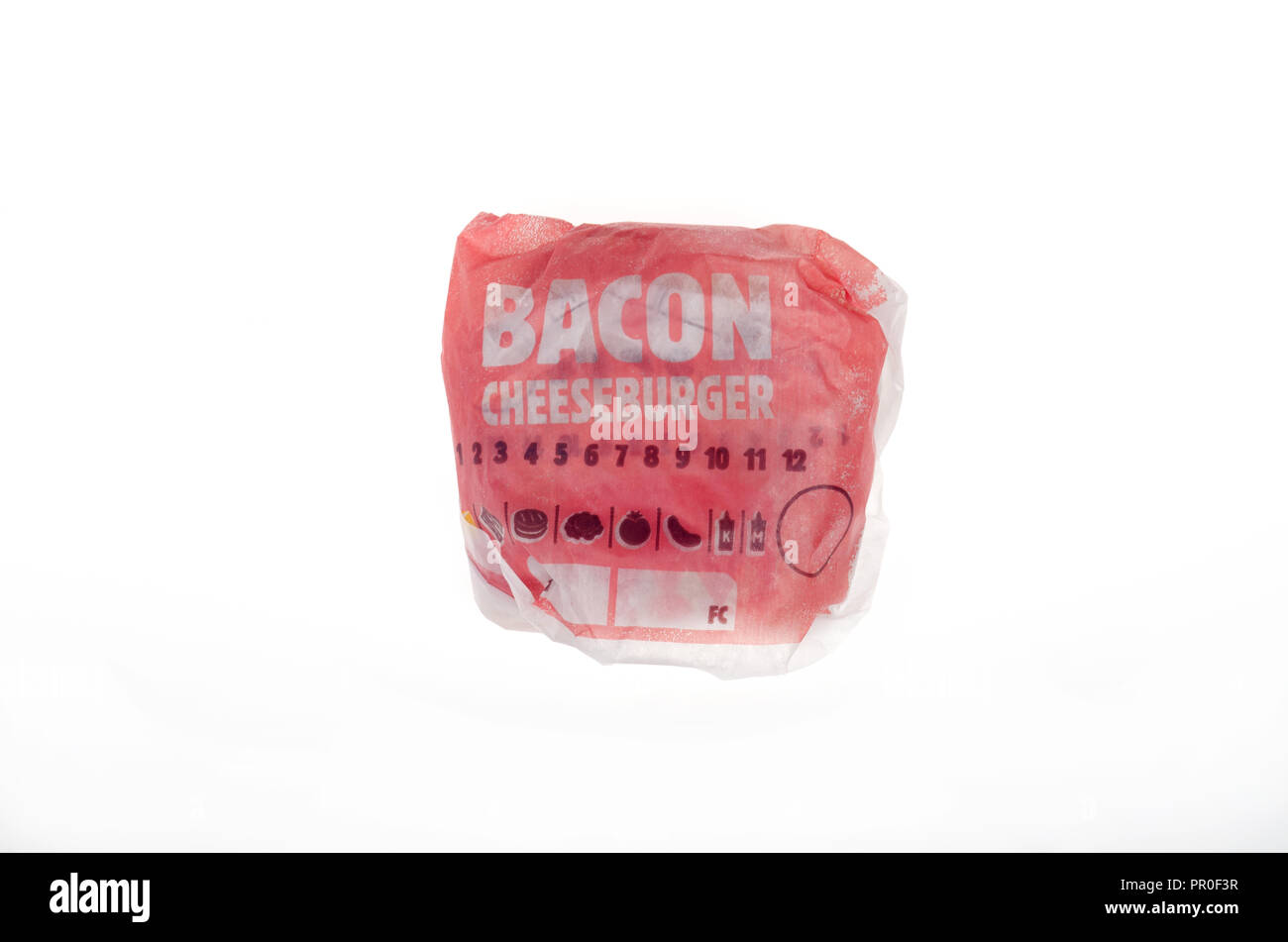 Burger King Bacon Cheeseburger in wrapper - Stock Image