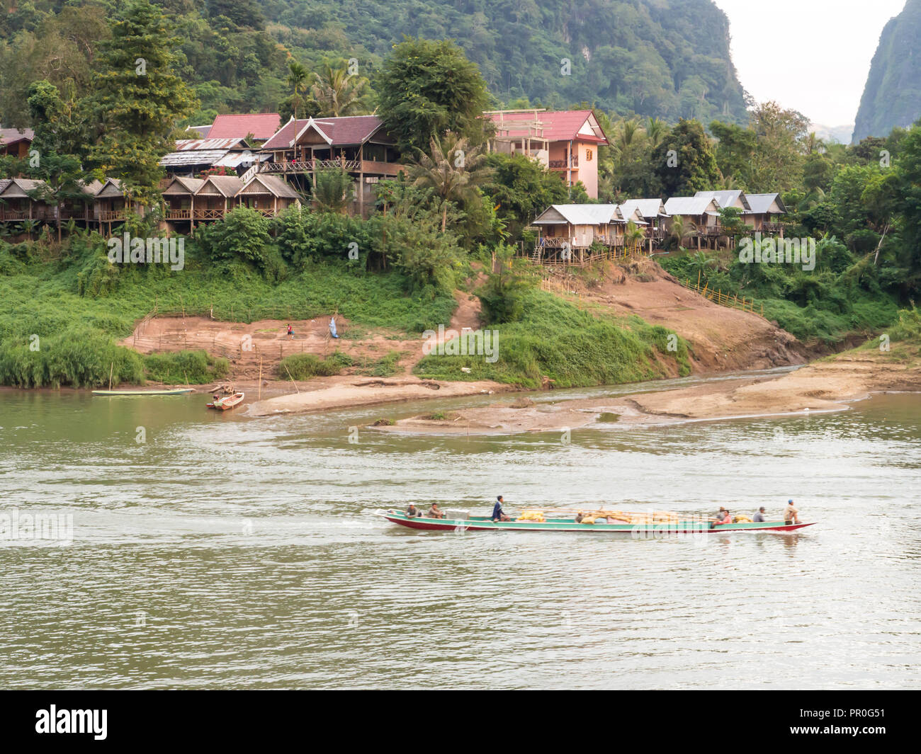 Riverboat and village, Nong Khiaw, Laos, Indochina, Southeast Asia, Asia - Stock Image