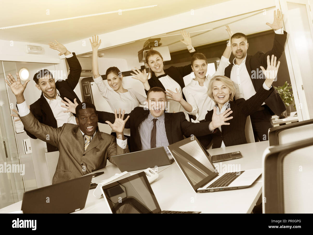 Professiona adult l international business team delighted with achievements of joint work in boardroom - Stock Image