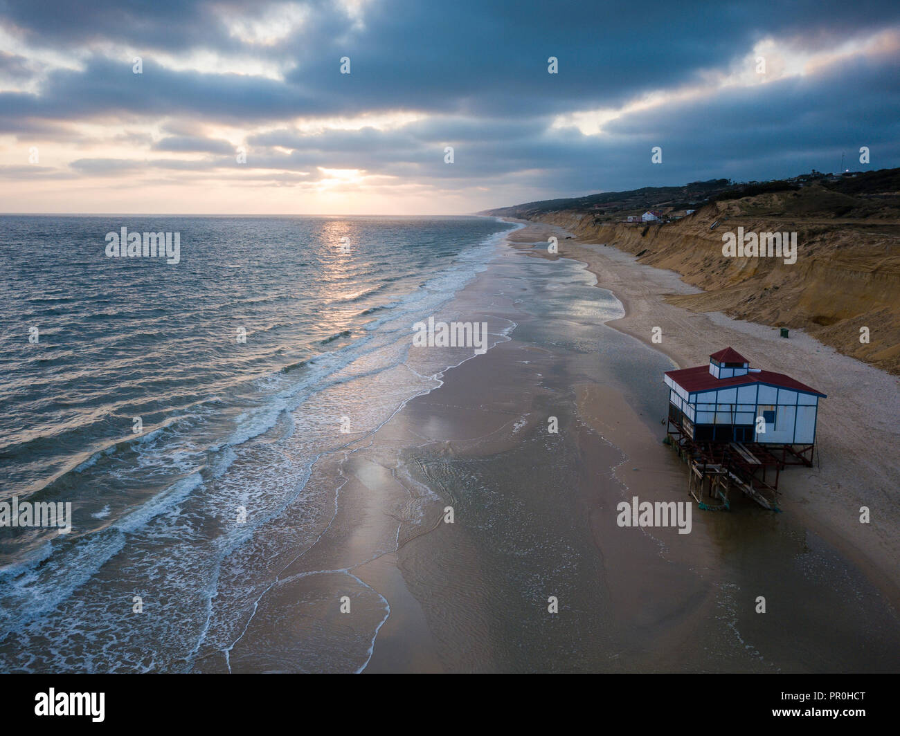 Aerial view of sunset over beach, by drone, Matalascanas, Huelva District, Andalucia, Spain, Europe - Stock Image