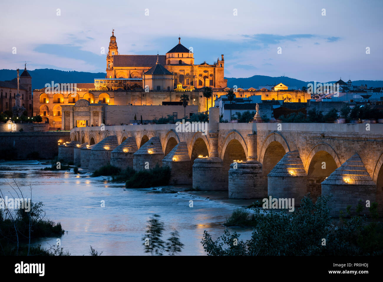 The Cathedral and Great Mosque of Cordoba (Mezquita) and Roman Bridge at twilight, UNESCO World Heritage Site, Cordoba, Andalucia, Spain, Europe - Stock Image