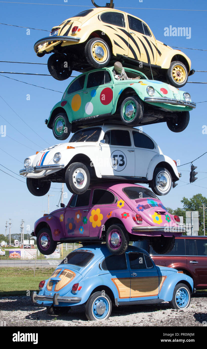 Stack of VW Bugs on a pole in Defiance, Ohio - Stock Image