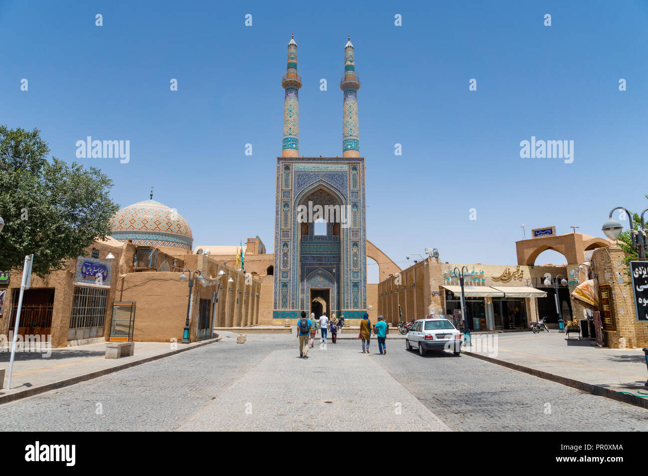 Yazd, Iran -  June 2018: Masjed-i Jame mosque in the old town of Yazd, Iran. - Stock Image