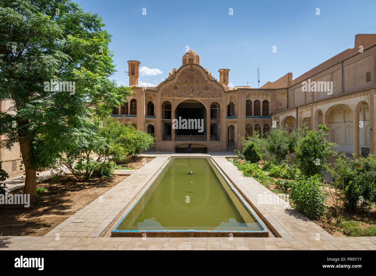 Kashan, Iran - June, 2018: Borodjerdi Mansion behind the fountains of its garden in Kashan, Iran. - Stock Image