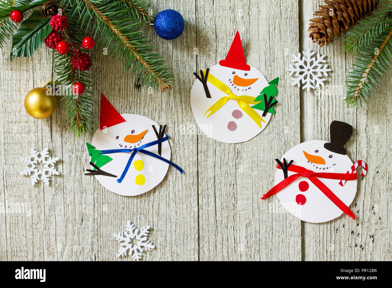 Christmas snowman merry gift on wooden table. Handmade. Project of ...