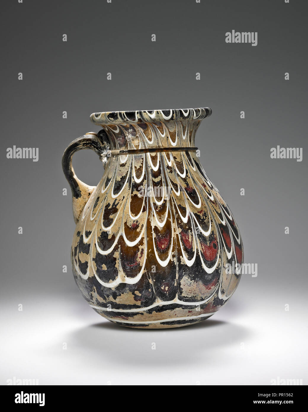 One-handled Cup; Eastern Mediterranean; about 2nd century; Glass; 12.8 cm, 5 1,16 in - Stock Image