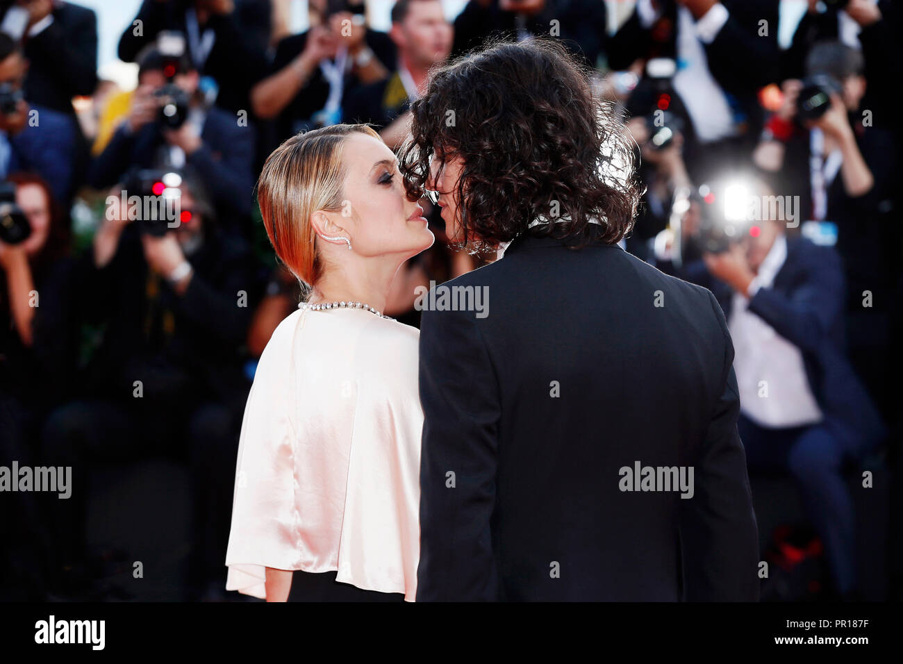 VENICE, ITALY - AUGUST 29: Singer Francesco Motta and actress Carolina Crescentini walk the red carpet of the opening ceremony during the 75th Venice  - Stock Image