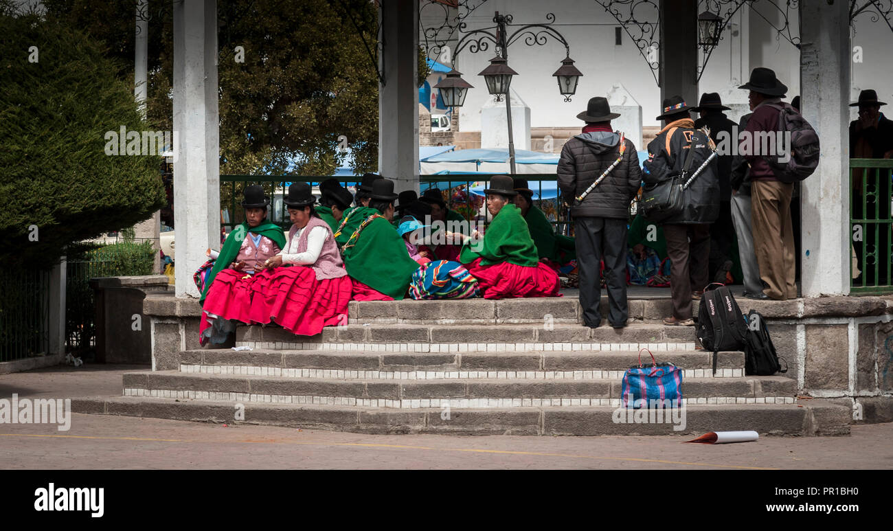 COPACABANA, BOLIVIA - AUGUST 18, 2017 : Unidentified Aymara people with typical bolivian dressed in Copacabana in Bolivia. - Stock Image