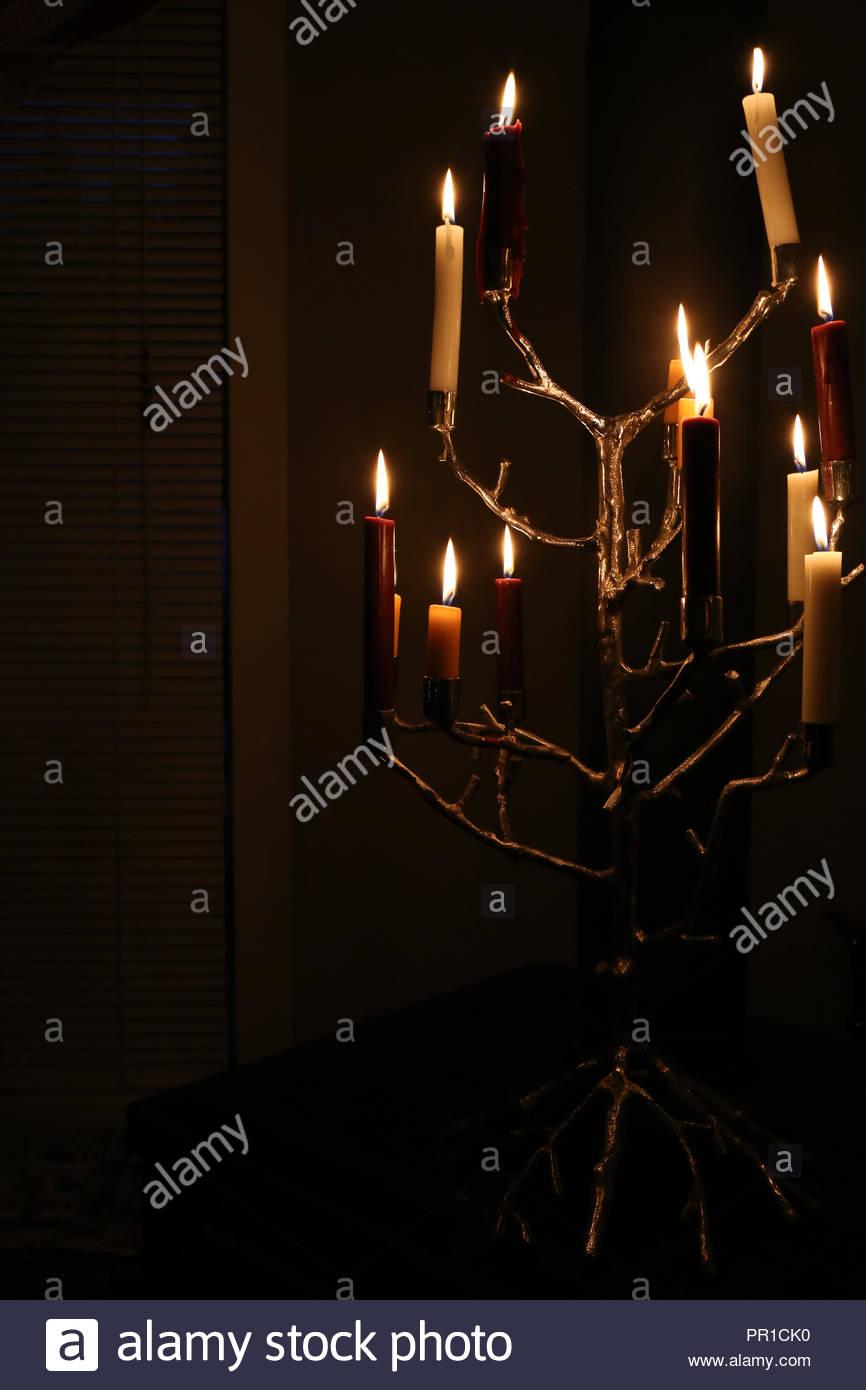 Glowing tree-inspired candelabra! - Stock Image