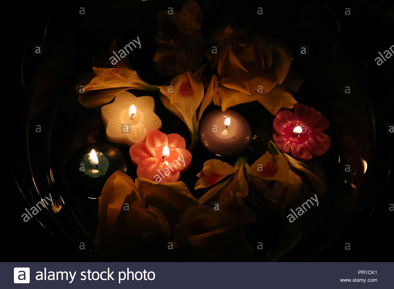 Ambient floating floral candles. - Stock Image