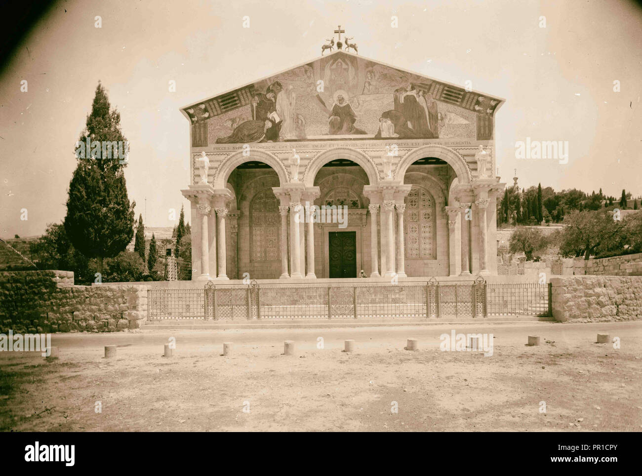 The Basilica of Gethsemane, Church of All Nations or Church of the Agony The fa ade showing portico and colorful mosaics. 1924 - Stock Image