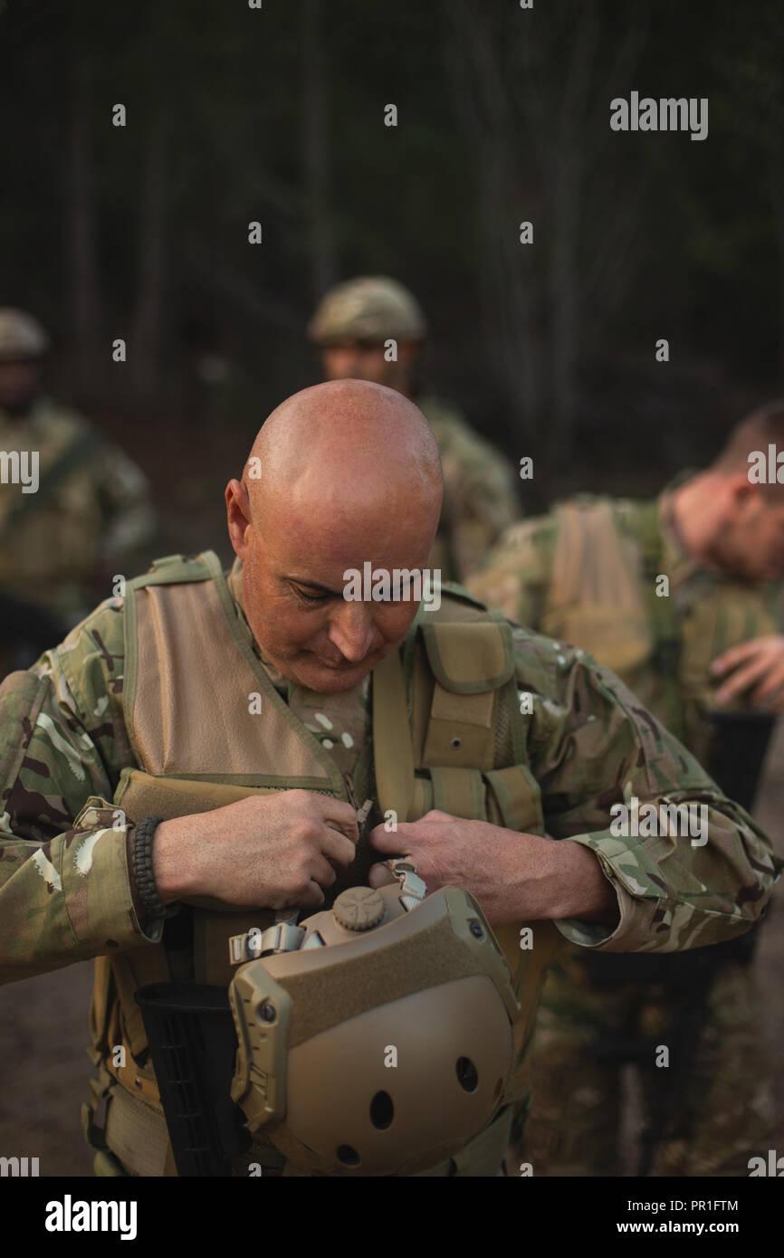 Military soldier wearing bulletproof vest - Stock Image